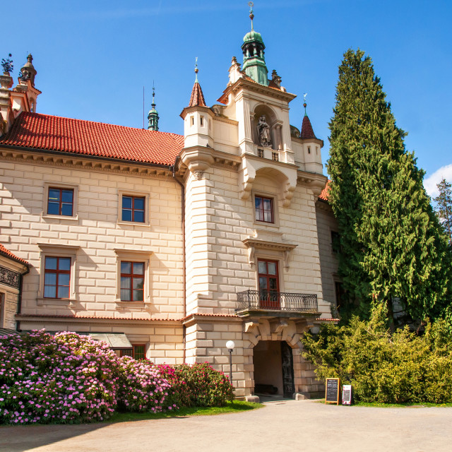 """""""Pruhonice Castle main entrance with shrubs of blooming Rhododend"""" stock image"""