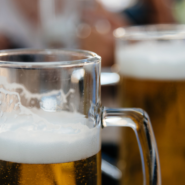 """Close-up of beer glass on table"" stock image"