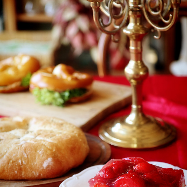 """""""Homemade bakery on the table at home: strawberry cake, flat pizza, stuffed sandwiches, soft focus"""" stock image"""