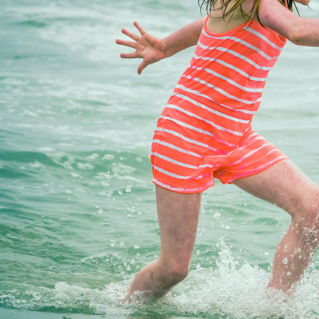 """""""Child Playing In The Waves"""" stock image"""