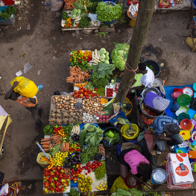 """Bissau, Republic of Guinea-Bissau - January 30, 2018: Vendors selling fruits and vegetables at the Bandim Market, in the city of Bissau, Guinea-Bissau"" stock image"