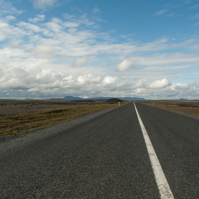 """Empty road in Iceland leading to the mountains"" stock image"