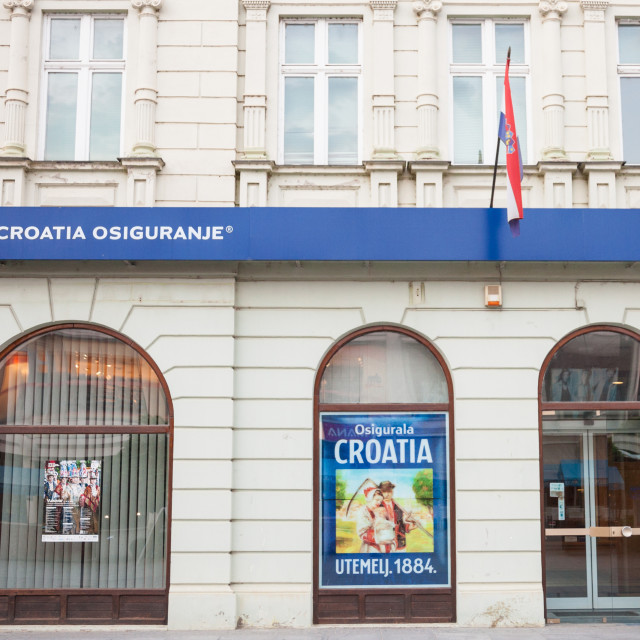 """VUKOVAR, CROATIA - MAY 12, 2018: Croatia Insurance on their main agency in Vukovar. Croatia Osiguranje is the old and biggest insurance company in Croatia, beloning to Adris Grupa"" stock image"