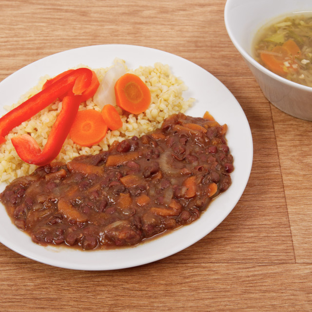 """Azuki with vegetables on steam and bulgur on a table"" stock image"