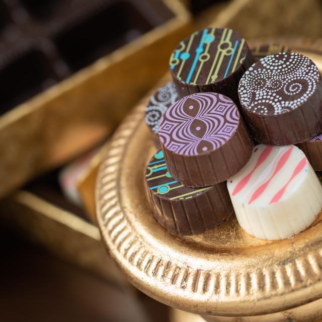 """Artisan Fine Chocolate Candy On Gold Pillar Serving Dish"" stock image"