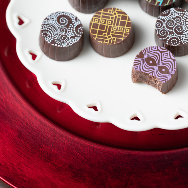 """""""Artisan Fine Chocolate Candy On Serving Dish with Heart Design"""" stock image"""