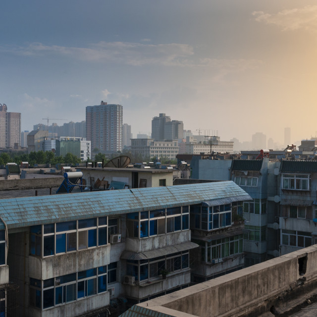 """Xian, China - August 6, 2012: View of the city of Xian at sunset, with residential buildings, in China, Asia"" stock image"