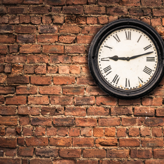"""""""Station Clock On A Red Brick Wall"""" stock image"""