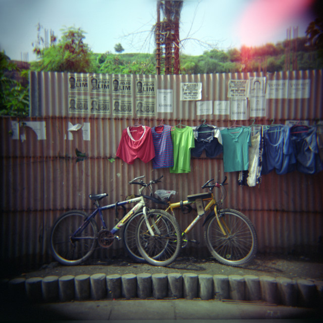 """""""Bikes against wall"""" stock image"""