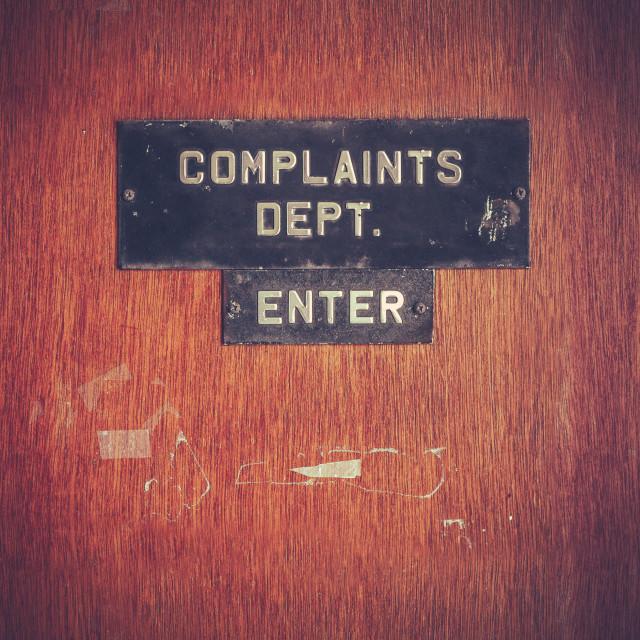 """""""Retro Grunge Complaints Dept Door"""" stock image"""