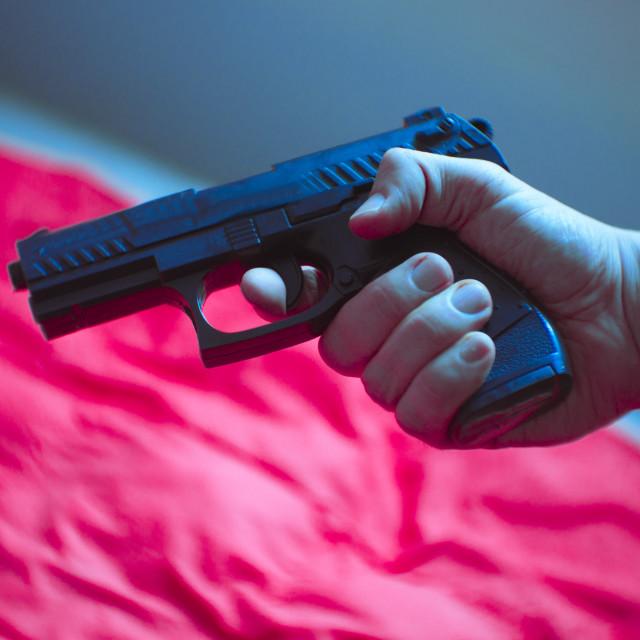 """""""Firearm held by a man"""" stock image"""