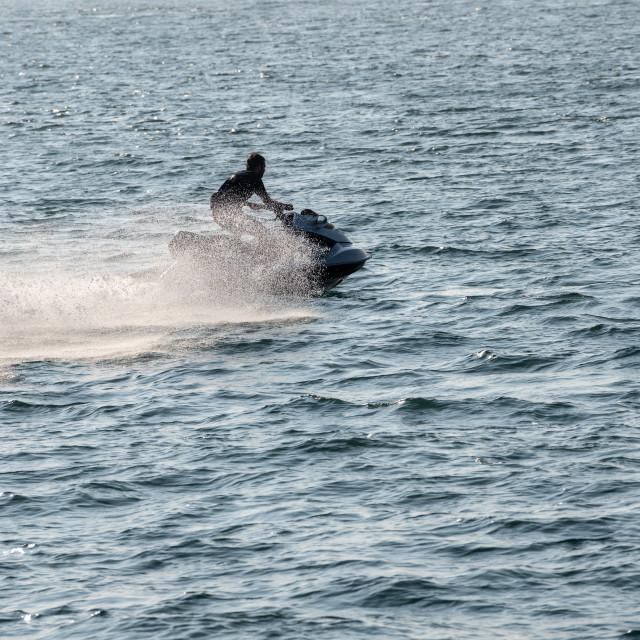 """""""Jet ski or wave runner in ocean off Ilfracombe"""" stock image"""