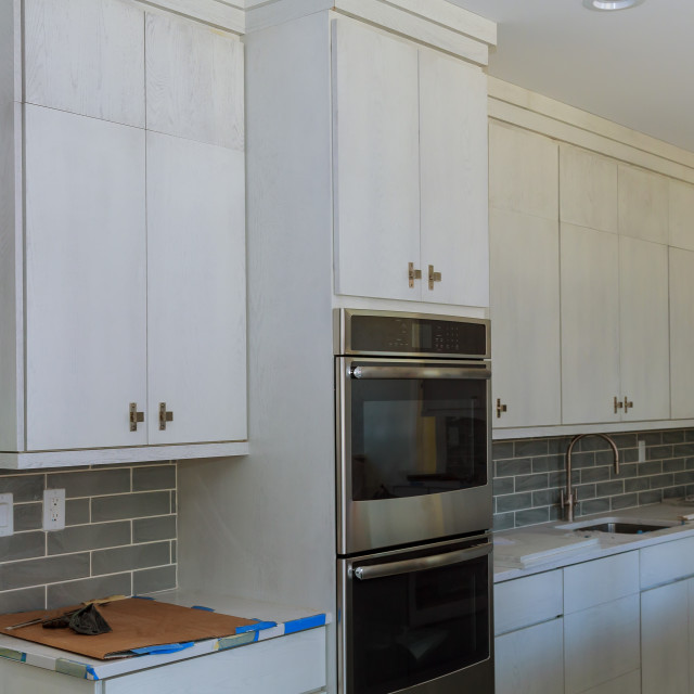 """""""Kitchen cabinets installation island drawers and counter cabinets installed"""" stock image"""