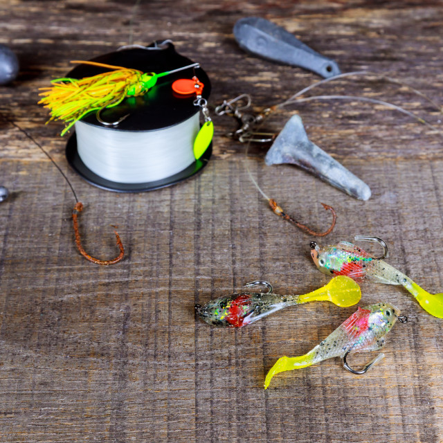 """set of fishing tackle on a wooden table"" stock image"