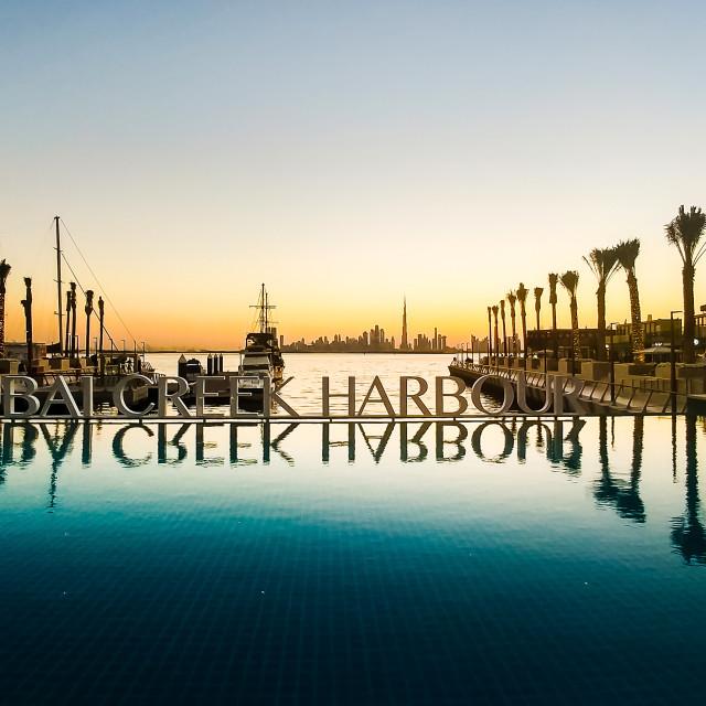 """Dubai Creek harbor romantic sunset scene"" stock image"