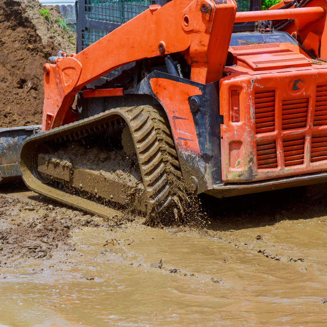 """Wheel loader Excavator with backhoe unloading earth at eathmoving works..."" stock image"