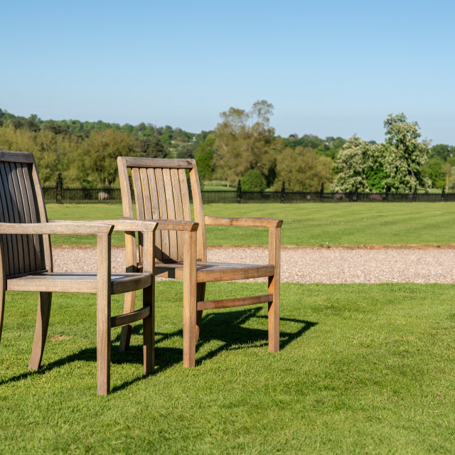 """""""Two teak chairs on lawn in large garden"""" stock image"""