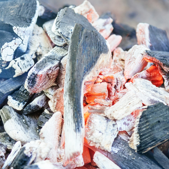 """""""Burning charcoal with orange-colored flame and glow Selective Focus, on parts..."""" stock image"""