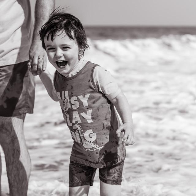 """Paddling Toddler black and white"" stock image"