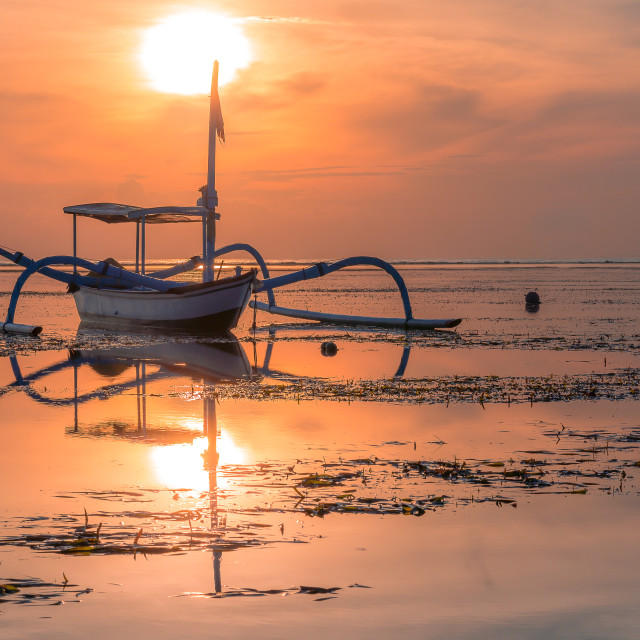 """""""A traditional balinese fishing boat at sunrise"""" stock image"""