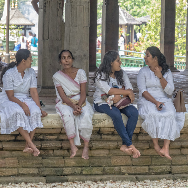"""Women in front of the temple"" stock image"