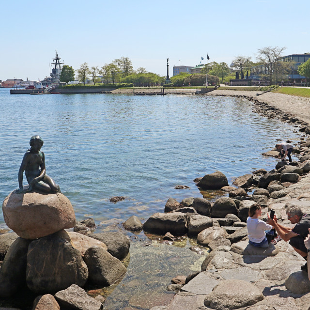"""""""COPENHAGEN, DENMARK - tourists take pictures and selfies with the Little mermaid"""" stock image"""