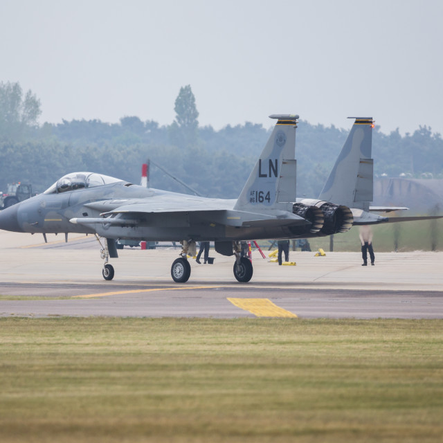 """""""F-15C Eagle taxis off the runway"""" stock image"""