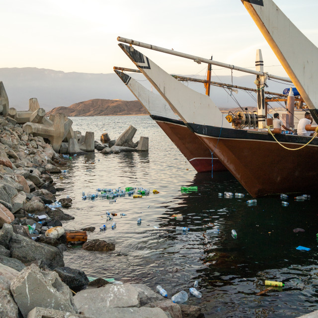 """Pollution in the sea in front of dhows in the port, Dhofar Governorate,..."" stock image"