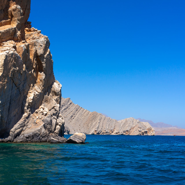 """Fjords in front of mountains, Musandam Governorate, Khasab, Oman"" stock image"