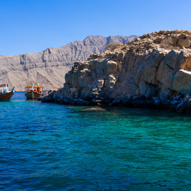 """Tourists snorkelling in telegraph island, Musandam Governorate, Khasab, Oman"" stock image"