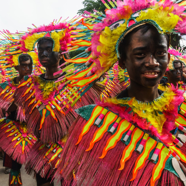 """""""Four participants in flamboyant coloured dress marching at the annual..."""" stock image"""