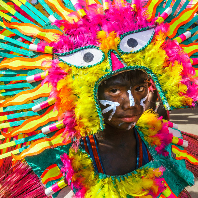 """""""Participant in flamboyant dress, eyes matching those on his costume, at the..."""" stock image"""