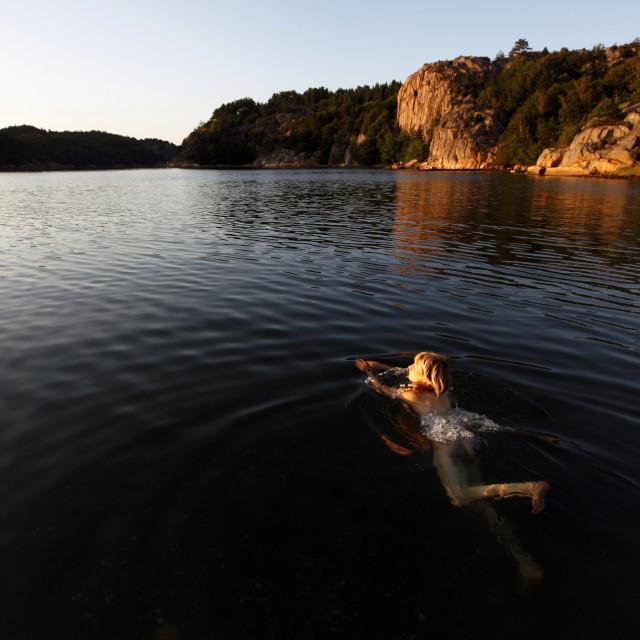 """A woman swimming on the Bohuslan coast, Sweden"" stock image"