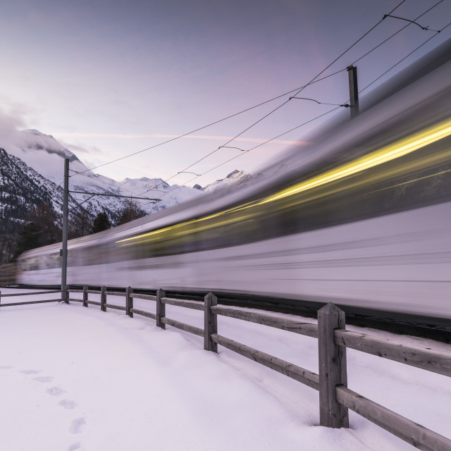 """Bernina Express train in the snowy landscape, Morteratsch, Engadine, Canton..."" stock image"