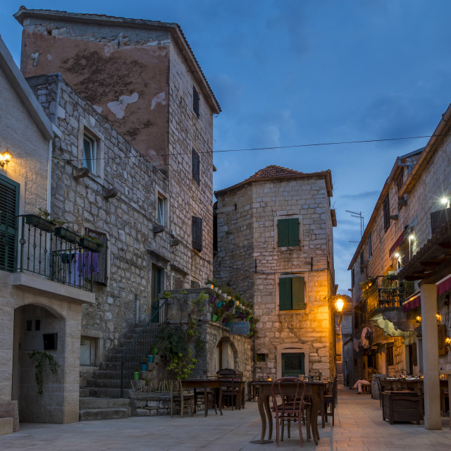 """""""Small square in the old town of Stari Grad on Hvar Island at dusk"""" stock image"""