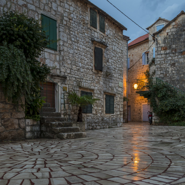 """""""Small square in the old town of Stari Grad on Hvar Island at dawn"""" stock image"""
