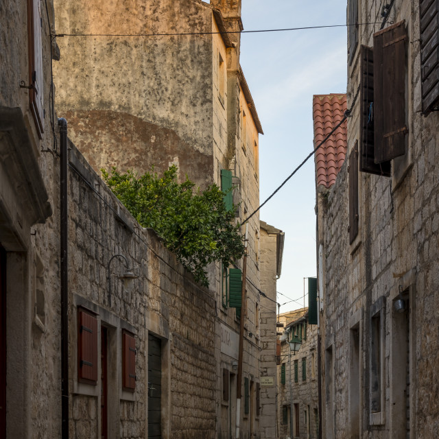 """""""Narrow street in the old town of Stari Grad on Hvar Island at first sunlight"""" stock image"""