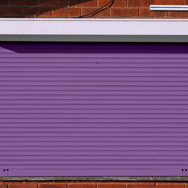 """""""Closed purple security shutters"""" stock image"""