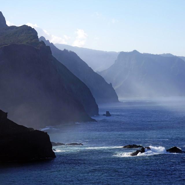"""The dramatic sea cliffs of the northwest coast rise beyond the Sao Lourenco..."" stock image"