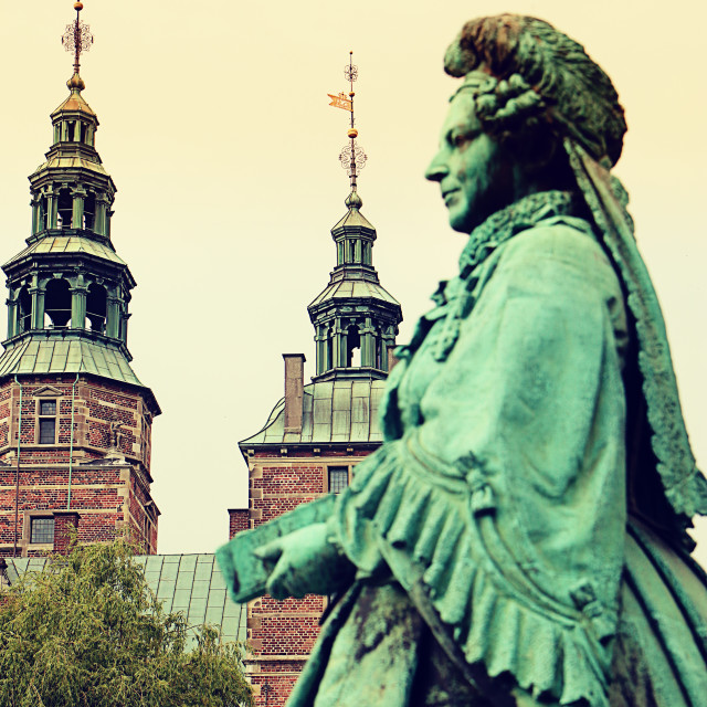 """COPENHAGEN, DENMARK - Rosenborg castle with the statue of Queen Caroline Amalie, soft focus"" stock image"