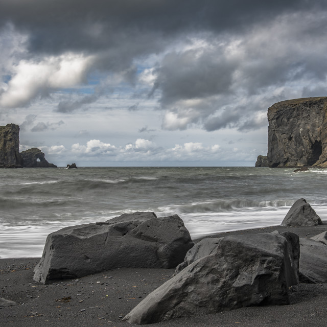 """Looking towards the Dyrhólaey peninsula from the Reynisfjara beach"" stock image"