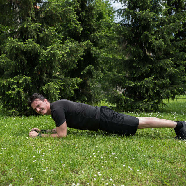 """young man in park exercising"" stock image"