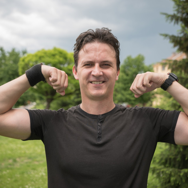"""man flexing the muscles"" stock image"
