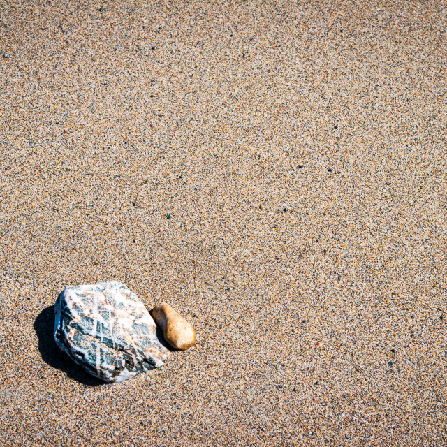 """Pebbles on sand"" stock image"