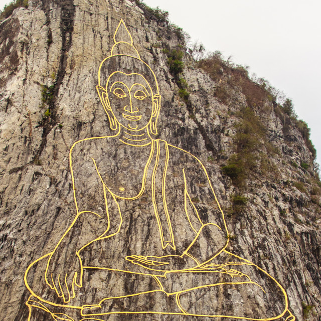 """Golden Buddha laser carved and inlayed with gold on Khao Chee Chan Cliff. One..."" stock image"