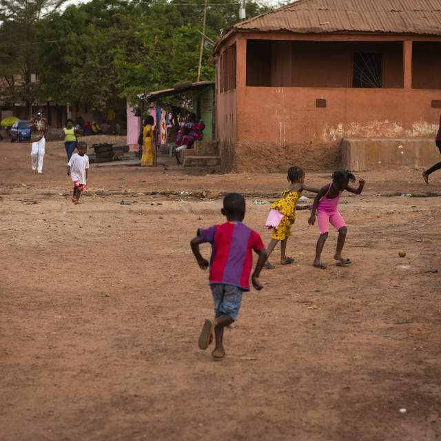 """Bissau, Republic of Guinea-Bissau - January 31, 2018: Group of children playing at the Cupelon de Baixo neighborhood in the city of Bissau, Guinea Bissau."" stock image"
