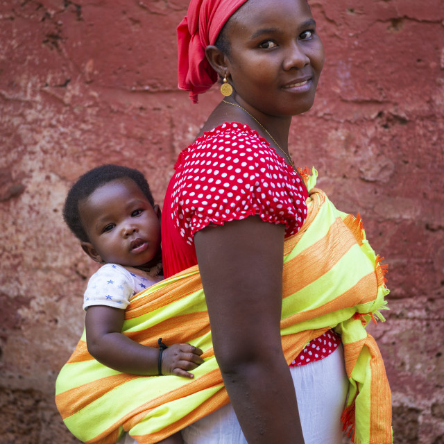 """""""Bissau, Republic of Guinea-Bissau - January 31, 2018: Portrait of a mother and her baby daughter at the Cupelon de Cima neighborhood in the city of Bissau, Guinea Bissau."""" stock image"""