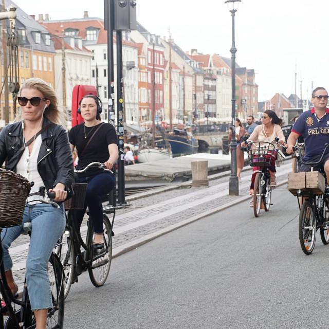 """COPENHAGEN, DENMARK - people on bike"" stock image"