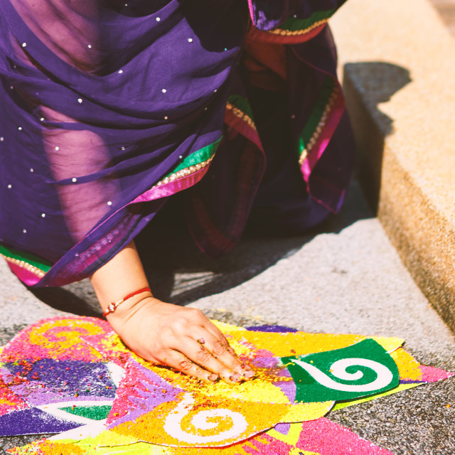 """""""Women decorating the traditional rice art (Rangoli) on the floor for indian wedding"""" stock image"""
