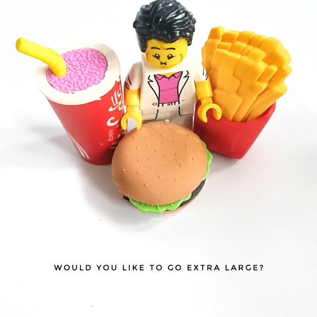"""Would you like to go extra large?"" stock image"